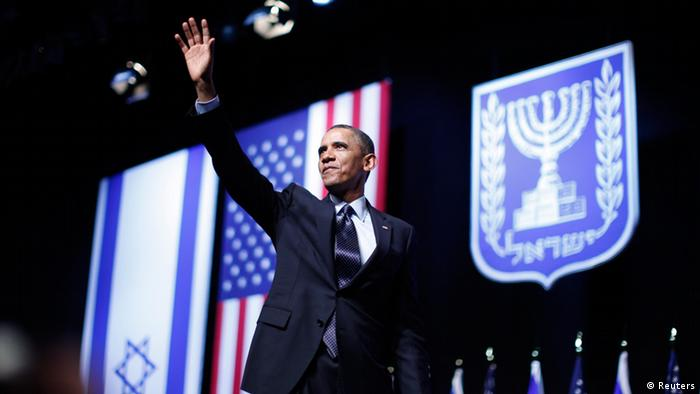 U.S. President Barack Obama acknowledges the audience after delivering a speech on policy at the Jerusalem Convention Center, March 21, 2013. President Obama, delivering a keynote speech to Israeli students, said on Thursday that continued settlement activity was counterproductive to peace and urged Israelis to accept the Palestinians' right to self-determination. REUTERS/Jason Reed (JERUSALEM - Tags: POLITICS)