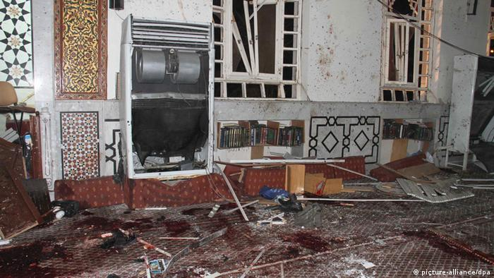 epa03634942 A handout picture made availabe the state-run Syrian news agency SANA shows the inside of al-Eman Mosque in the neighborhood of al-Mazraa in Damascus, Syria, 21 March 2013. A car bomb targeting the Iman mosque killed at least 16 people, including a prominent pro-regime Sunni clergyman, the Syrian Observatory for Human Rights activist group said. Syrian State television blamed the death of Sheikh Mohamed Said al-Bouti on 'terrorist gangs', a term used by the regime of President Bashar al-Assad to refer to rebels fighting for his overthrow. EPA/SANA / HANDOUT HANDOUT EDITORIAL USE ONLY/NO SALES