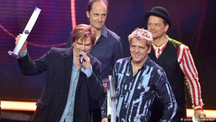 Members of German band Die Toten Hosen, Campino (L-R), Michael Breitkopf and Andreas Meurer receive the 2013 Echo Music Award in the category 'group national rock/pop' at the Echo Awards ceremony in Berlin, Germany, 21 March 2013. Photo: Britta Pedersen/dpa