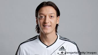 GettyImages 143320446 HAMBURG, GERMANY - NOVEMBER 14: Mesut Oezil of Germany poses during a national team photocall on November 14, 2011 in Hamburg, Germany. (Photo by Oliver Hurst - Pool/Bongarts/Getty Images)