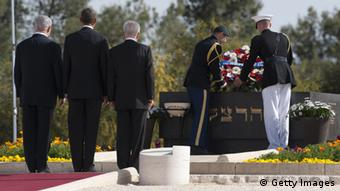 US President Barack Obama (C) stands with Israeli Prime Minister Benjamin Netanyahu (L) and Israeli President Shimon Peres (R) during a wreath laying ceremony at the grave of Theodor Herzl at Mt. Herzl in Jerusalem, on March 22, 2013, on the final day of Obama's 3-day trip to Israel and the Palestinian territories. AFP PHOTO / Saul LOEB (Photo credit should read SAUL LOEB/AFP/Getty Images)