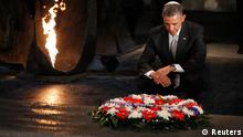 U.S. President Barack Obama pauses for a moment as he lays a wreath at the Hall of Remembrance during his visit to the Yad Vashem Holocaust Memorial in Jerusalem, March 22, 2013. REUTERS/Jason Reed (JERUSALEM - Tags: POLITICS)