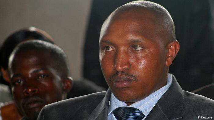 Fugitive Congolese warlord Bosco Ntaganda attends rebel commander Sultani Makenga's wedding in Goma December 27, 2009. Ntaganda walked into the U.S. Embassy in Rwanda on March 18, 2013 and asked to be transferred to the International Criminal Court, where he faces war crimes charges racked up during years of rebellion. Picture taken December 27, 2009. REUTERS/Paul Harera (DEMOCRATIC REPUBLIC OF CONGO - Tags: CIVIL UNREST CRIME LAW MILITARY POLITICS SOCIETY)