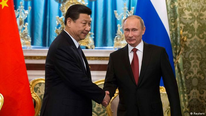 Russia's President Vladimir Putin (R) shakes hands with his Chinese counterpart Xi Jinping during a meeting at the Kremlin in Moscow March 22, 2013. Photo: REUTERS/Alexander Zemlianichenko/Pool
