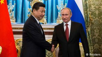 Russia's President Vladimir Putin (R) shakes hands with his Chinese counterpart Xi Jinping during a meeting at the Kremlin in Moscow March 22, 2013.