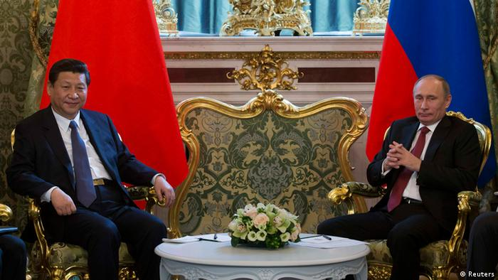 Russia's President Vladimir Putin (R) meets with his Chinese counterpart Xi Jinping at the Kremlin in Moscow March 22, 2013. REUTERS/Alexander Zemlianichenko/Pool (RUSSIA - Tags: POLITICS)