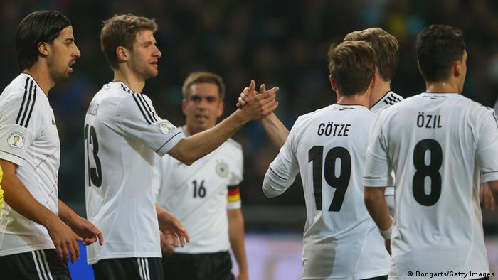 GettyImages 164290896 ASTANA, KAZAKHSTAN - MARCH 22: Thomas Mueller (2nd L) of Germany celebrates scoring the 2nd team goal with his team mates during the FIFA 2014 World Cup qualifier group C match between Kazakhstan and Germany at Astana Arena on March 22, 2013 in Astana, Kazakhstan. (Photo by Alexander Hassenstein/Bongarts/Getty Images)