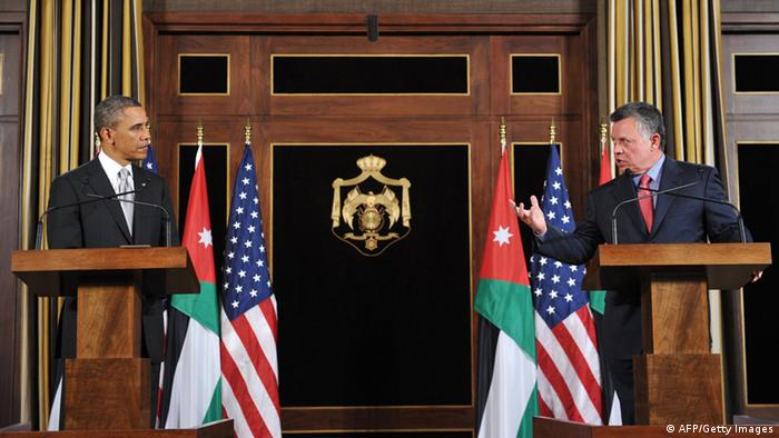 GettyImages 164290941 Jordan's King Abdullah II speaks during a joint press conference with US President Barack Obama (L) following a meeting at Al-Hummar Palace in Amman on March 22, 2013. Obama arrived in Jordan to face scrutiny over his Syria strategy, on the last leg of a Middle East tour after visits to Israel and the Palestinian territories. AFP PHOTO/Mandel NGAN (Photo credit should read MANDEL NGAN/AFP/Getty Images)