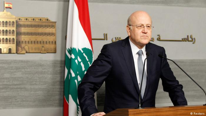 Lebanon's Prime Minister Najib Mikati speaks during a news conference at the Grand Serail, the government headquarters in Beirut, March 22, 2013. Lebanon's Prime Minister Najib Mikati announced his resignation on Friday after Shi'ite group Hezbollah and its allies blocked the creation of a body to supervise parliamentary elections and opposed extending the term of a senior security official. REUTERS/Mohamed Azakir (LEBANON - Tags: POLITICS)