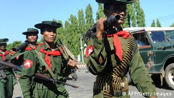 Myanmar military troops arrive in Sittwe, capital of Myanmar's western Rakhine state, on October 31, 2012.