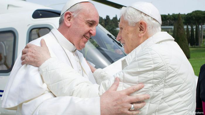 Pope Francis (L) embraces Pope Emeritus Benedict XVI as he arrives at the Castel Gandolfo summer residence March 23, 2013. Pope Francis travelled by helicopter from the Vatican to Castel Gandolfo for a private meeting with the former Pope Benedict XVI. REUTERS/Osservatore Romano (ITALY - Tags: RELIGION TPX IMAGES OF THE DAY) ATTENTION EDITORS - THIS IMAGE WAS PROVIDED BY A THIRD PARTY. FOR EDITORIAL USE ONLY. NOT FOR SALE FOR MARKETING OR ADVERTISING CAMPAIGNS. THIS PICTURE IS DISTRIBUTED EXACTLY AS RECEIVED BY REUTERS, AS A SERVICE TO CLIENTS