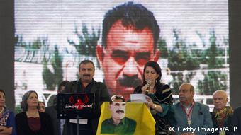 Pro-Kurdish politicians Sirri Sureyya Onder (L) and Pelvin Buldan (R) read jailed Kurdish rebel chief Abdullah Ocalan's message on March 21, 2013, in the southern Turkish city of Diyarbakir. The festival is celebrated in Turkey, Central Asian republics, Iraq, Iran, Azerbaijan as well as war-torn Afghanistan and coincides with the astronomical vernal equinox. Jailed Kurdish rebel chief Abdullah Ocalan called on March 21 for a ceasefire, telling militants to lay down their arms and withdraw from Turkish soil, raising hopes for an end to a three-decade conflict with Turkey that has cost tens of thousands of lives. Turkish Prime Minister Recep Tayyip Erdogan responded cautiously to the much-anticipated announcement by saying Turkey would end military operations against Ocalan's outlawed Kurdistan Workers' Party (PKK) if militants halt their attacks. AFP PHOTO / STRINGER (Photo credit should read STR/AFP/Getty Images)