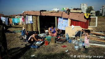 A Roma family wash clothes, in a makeshift camp DIMITAR DILKOFF/AFP/Getty Images