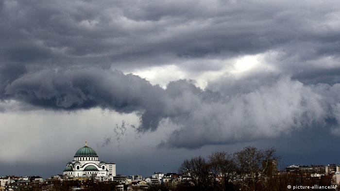 Dark clouds are seen before rain over St. Sava Serbian Orthodox church, the largest Orthodox place of worship in the Balkans and one of the largest Orthodox churches in the world, in Belgrade, Serbia, one day before the start of spring, Tuesday, March 19, 2013. (AP Photo/Darko Vojinovic)
