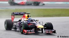 Red Bull Formula One driver Sebastian Vettel of Germany drives during the Malaysian F1 Grand Prix at Sepang International Circuit outside Kuala Lumpur, March 24, 2013. REUTERS/Bazuki Muhammad (MALAYSIA - Tags: SPORT MOTORSPORT F1) Edit status: New