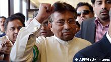 Pakistan's former military ruler Pervez Musharraf gestures upon his arrival at the Karachi International airport from Dubai, in Karachi on March 24, 2013 (Photo: AAMIR QURESHI/AFP/Getty Images)