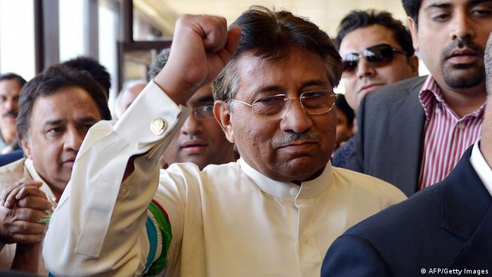 Pakistan's former military ruler Pervez Musharraf gestures upon his arrival at the Karachi International airport from Dubai, in Karachi on March 24, 2013. (Photo: AAMIR QURESHI/AFP/Getty Images)