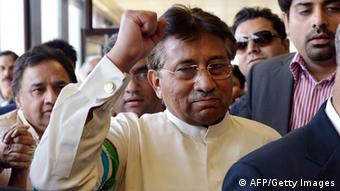Pervez Musharraf gestures upon his arrival at the Karachi International airport from Dubai, in Karachi on March 24, 2013. (Photo: AAMIR QURESHI/AFP/Getty Images)