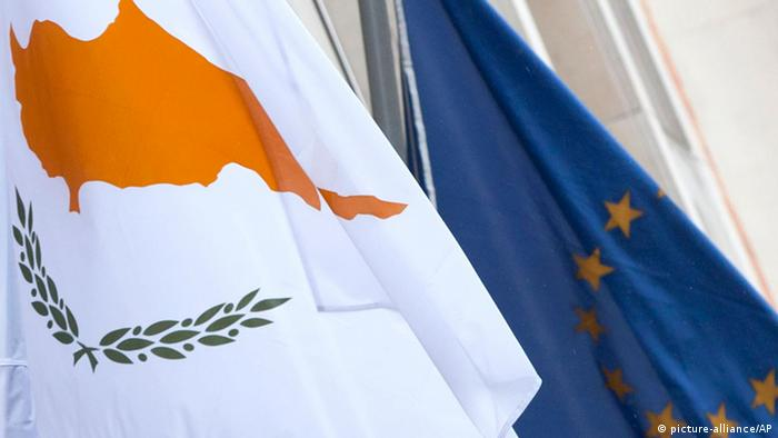 The Cyprus, left, and EU flag are seen at the Cyprus delegation building in Brussels (Photo: AP Photo/Virginia Mayo)