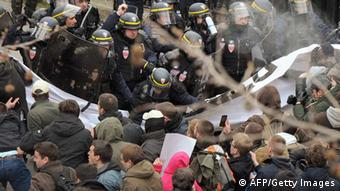 People clash with riot police during a demonstration against France's gay marriage law in an attempt to block legislation that will allow homosexual couples to marry and adopt children, on March 24, 2013 in Paris. The hugely controversial bill to legalise same-sex marriage and adoption has been comfortably adopted by the lower chamber of parliament and will go to the Senate for examination and approval in April. AFP PHOTO / PIERRE ANDRIEU (Photo credit should read PIERRE ANDRIEU/AFP/Getty Images)
