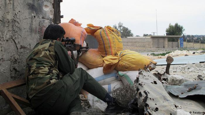 A Free Syrian Army fighter takes position behind sandbags in Aleppo March 19, 2013. Picture taken March 19, 2013. REUTERS/Abdalghne Karoof (SYRIA - Tags: CONFLICT)
