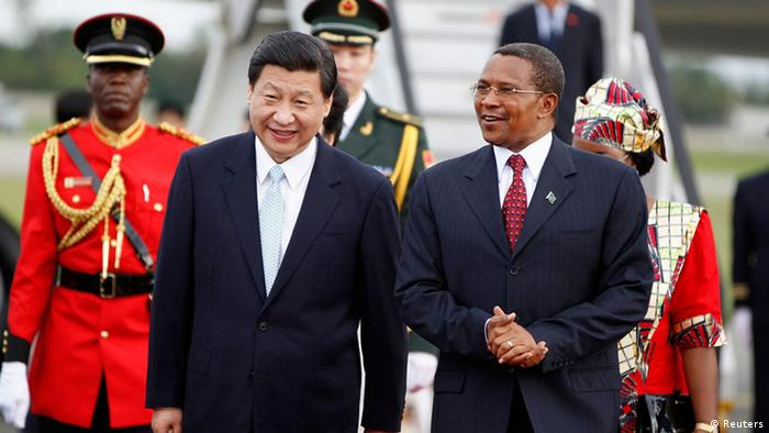 China's President Xi Jinping (front L) walks with his Tanzanian counterpart Jakaya Kikwete (front R) upon his arrival at Julius Nyerere International Airport in Dar es Salaam, March 24, 2013. Xi faces growing calls from policymakers and economists in Africa for a more balanced trade relationship between the continent and China as he arrives in Tanzania at the beginning of an African tour on Sunday. REUTERS/Thomas Mukoya (TANZANIA - Tags: BUSINESS POLITICS)