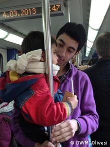 Man holding child in a bus Copyright: Marine Olivesi, DW Mitarbeiterin, March 2013 04/03/13