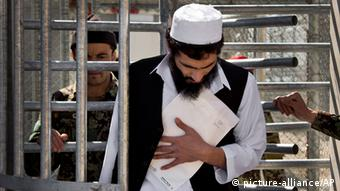A prisoner leaving Bagram in March 2013 holding his release papers Photo: (AP Photo/Anja Niedringhaus)