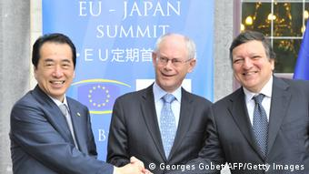 Japan Prime Minister Naoto Kan (L) shakes hands with EU Council President Herman Van Rompuy (C) and European Commission President Jose Manuel Barroso (R) during a welcome ceremony prior to the 20th EU-Japan summit at the Val Duchesse castle in Brussels on 28 May 2011. An EU-Japan summit seeking to elevate ties between the world's third economy and leading market to a new dimension, looks set to stumble on prickly differences over trade. AFP PHOTO / GEORGES GOBET (Photo credit should read GEORGES GOBET/AFP/Getty Images)