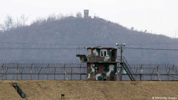 Military guard posts of South Korea (front) and North Korea (far) stand opposite each other as seen from in the border city of Paju on March 20, 2013. North Korea on March 20 condemned training flights by nuclear-capable US B-52 bombers over the Korean peninsula as an 'unpardonable provocation' and threatened military action if they continue. AFP PHOTO / JUNG YEON-JE (Photo credit should read JUNG YEON-JE/AFP/Getty Images)
