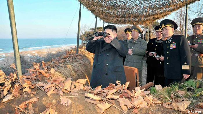 North Korean leader Kim Jong-Un (L) watches soldiers of the Korean People's Army (KPA) taking part in the landing and anti-landing drills of KPA Large Combined Units 324 and 287 and KPA Navy Combined Unit 597, in the eastern sector of the front and the east coastal area on March 25, 2013, in this picture released by the North's KCNA news agency in Pyongyang March 26, 2013. REUTERS/KCNA (NORTH KOREA - Tags: POLITICS MILITARY) ATTENTION EDITORS - THIS PICTURE WAS PROVIDED BY A THIRD PARTY. REUTERS IS UNABLE TO INDEPENDENTLY VERIFY THE AUTHENTICITY, CONTENT, LOCATION OR DATE OF THIS IMAGE. THIS PICTURE IS DISTRIBUTED EXACTLY AS RECEIVED BY REUTERS, AS A SERVICE TO CLIENTS. QUALITY FROM SOURCE. NO THIRD PARTY SALES. NOT FOR USE BY REUTERS THIRD PARTY DISTRIBUTORS