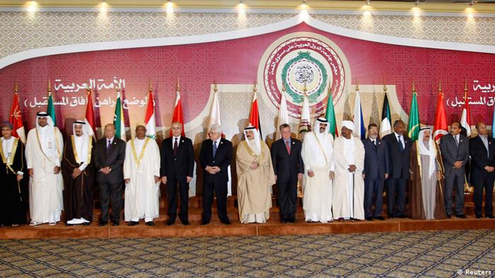 Heads of Arab states gather for a group photo during the opening of the Arab League summit in Doha March 26, 2013. A summit of Arab heads of state opened in the Qatari capital Doha on Tuesday expected to focus on the war in Syria as well as on the Israeli-Palestinian conflict. REUTERS/Ahmed Jadallah (QATAR - Tags: POLITICS ROYALS)