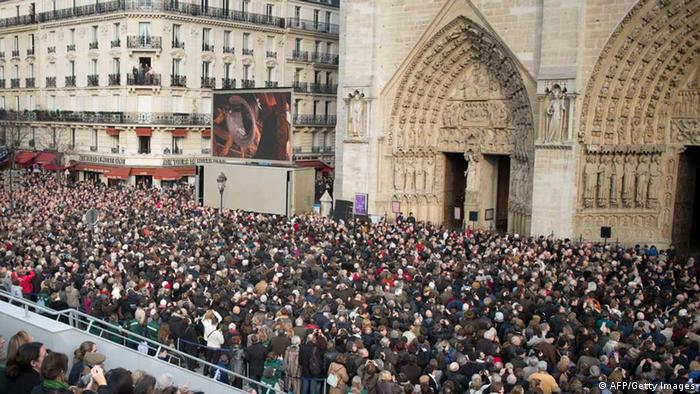 People listen the ringing of the new bells of Notre Dame Cathedral in Paris, as part of the formal inauguration (AFP/Getty Images)