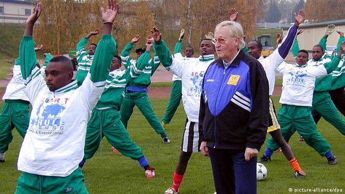 Rudi Gutendorf training Rwandan footballers