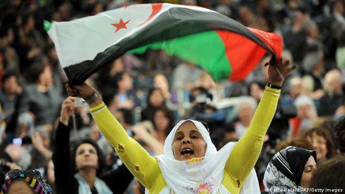 A supporter of the Polisario Front separatist movement waves the party's flag as she shouts slogans at the opening of the World Social Forum (WSF) on March 26, 2013 in Tunis. More than two years after the Jasmine revolution, tens of thousands of people are expected for the WSF, dubbed the forum of 'dignity', a watchword of the Tunisian uprising that inspired revolts across the Arab world. AFP PHOTO / FETHI BELAID (Photo credit should read FETHI BELAID/AFP/Getty Images)