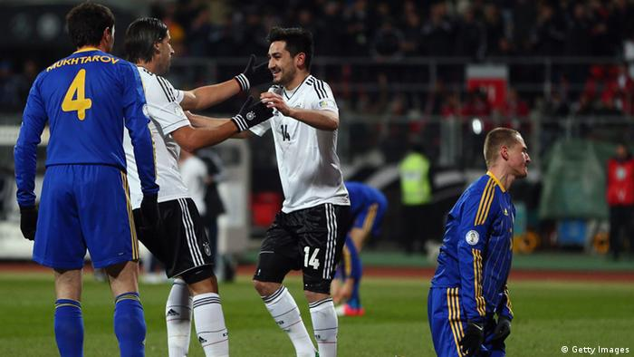 Ilkay Gündogan of Germany celebrates his team's third goal with team mate Sami Khedira (Photo by Alex Grimm/Bongarts/Getty Images)