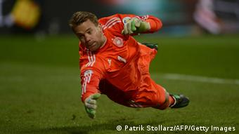 German goalkeeper Manuel Neuer dives for a ball during Germany vs Kazakhstan (Photo: PATRIK STOLLARZ/AFP/Getty Images)