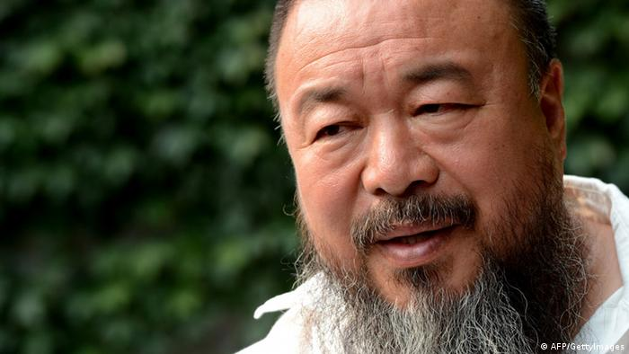In a photo taken on June 25, 2012 Chinese artist Ai Weiwei speaks to AFP inside his compound in Beijing. Ai has a metaphor for the travel ban that will prevent him attending the growing number of exhibitions of his work being held around the world as his renown increases. AFP PHOTO / Ed Jones (Photo credit should read Ed Jones/AFP/GettyImages)