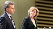 European Commissioner for Energy, Guenther Oettinger (L), from Germany, and European Climate Action Commissioner Connie Hedegaard (R), from Denmark, speak at a news briefing for the kick-off public debate on the 2030 energy and climate framework, at the EU headquarters in Brussels, Belgium, 27 March 2013. (Photo: Olivier Hoslet)