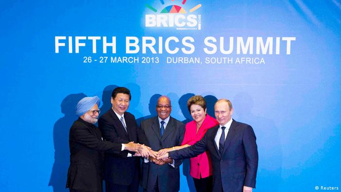 (L-R) Indian Prime Minister Manmohan Singh, Chinese President Xi Jinping, South African President Jacob Zuma, Brazilian President Dilma Rousseff and Russian President Vladimir Putin pose for a family photograph during the fifth BRICS Summit in Durban, March 27, 2013. REUTERS/Rogan Ward (SOUTH AFRICA - Tags: POLITICS BUSINESS)