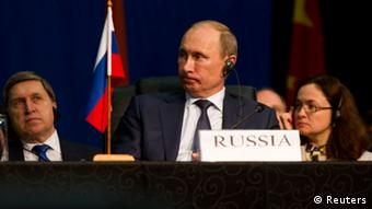 Russian President Vladimir Putin listens during closing remarks during the fifth BRICS Summit in Durban, March 27, 2013. REUTERS/Rogan Ward (SOUTH AFRICA - Tags: POLITICS)