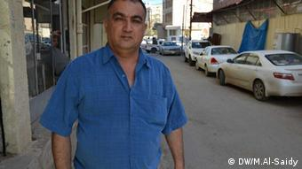 Office of marriage in Sulaymaniyah. Photo titl\ Mohammad Reza Majid, a shopkeeper, Sulaymaniyah, Iraq. Place and Date: Iraq, Sulaymaniyah, March, 27,2013. Copyright\ Photographer: Munaf Al-saidy.