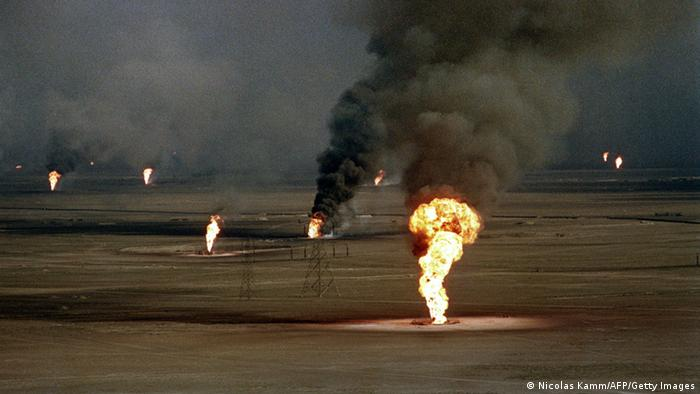 Burning oil wells damaged by retreating Iraqi soldiers