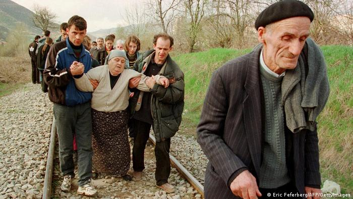 After being forced to leave the train, ethnic Albanian refugees continue their journey from Kosovo to Macedonia by foot in April 1999.