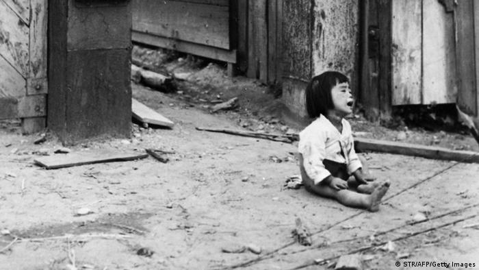 An abandoned girl shown in file photo dated 26 September 1950 crying in the streets of Inchon, South Korea during the the Korean War 1950-1953. (Photo: STR/AFP/Getty Images)