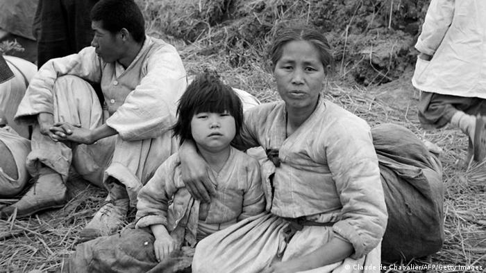 Korean refugees take a rest on April 04, 1951 in Korea during the Korean war. (Photo: CLAUDE DE CHABALIER/AFP/Getty Images)