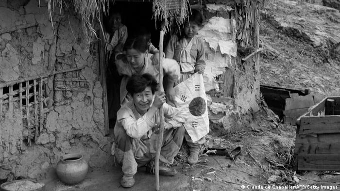 A Korean family stands in front of her hut in Chorwon, in July 1951 during the Korean War. (Photo: CLAUDE DE CHABALIER/AFP/Getty Images)