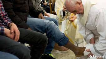 Pope Francis washes the foot of a prisoner at Casal del Marmo youth prison in Rome March 28, 2013. Two young women were among 12 people whose feet Pope Francis washed and kissed at a traditional ceremony in a Rome youth prison on Holy Thursday, the first time a pontiff has included females in the rite. REUTERS/Osservatore Romano (ITALY - Tags: RELIGION TPX IMAGES OF THE DAY) FOR EDITORIAL USE ONLY. NOT FOR SALE FOR MARKETING OR ADVERTISING CAMPAIGNS. THIS IMAGE HAS BEEN SUPPLIED BY A THIRD PARTY. IT IS DISTRIBUTED, EXACTLY AS RECEIVED BY REUTERS, AS A SERVICE TO CLIENTS