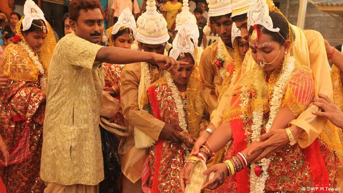 Couples during a mass marriage ceremony in Calcutta, India on 17 March 2013
