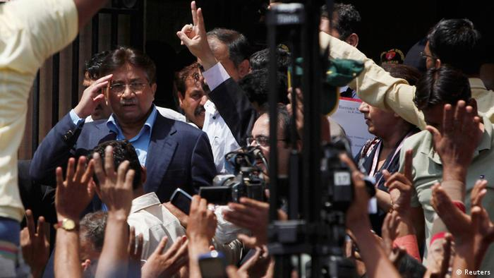 Pakistan's former President Pervez Musharraf (L) salutes his supporters as he leaves after his appearance before the district High Court in Karachi March 29, 2013. The Sindh High Court on Friday granted a bail extension to Musharraf, local media reported. REUTERS/Akhtar Soomro (PAKISTAN - Tags: POLITICS CRIME LAW)
